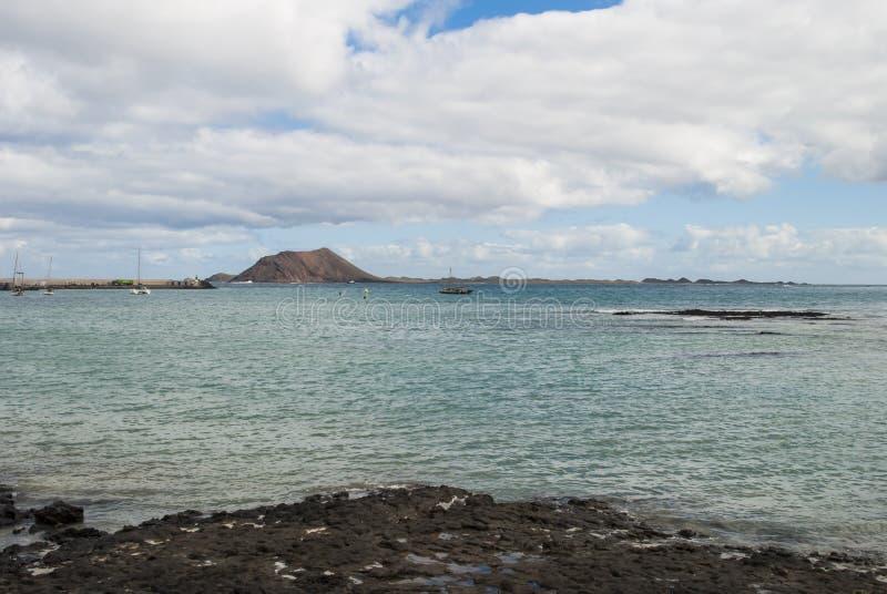 Isla de los Lobos. Canary islands - corralejo beach, fuerteventura - isla de los lobos and lanzarote islands at background royalty free stock photography