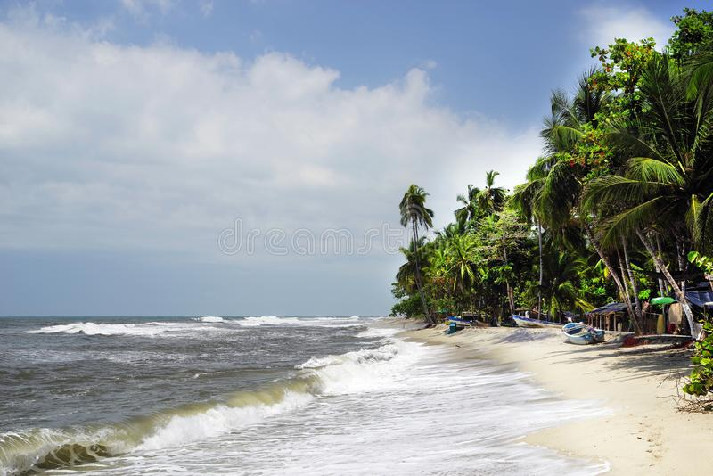 The Carribean Sea and one of its beautiful beaches on Isla Grande, Rosario Archipelago. Isla Grande is the largest island in the Rosario archipelago. The Coral stock images