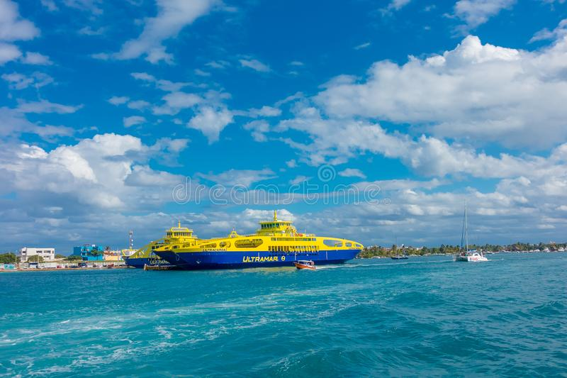 ISLA MUJERES, MEXICO, JANUARY 10, 2018: Outdoor view of huge boat of color blue and yellow sailing in the waters close stock images