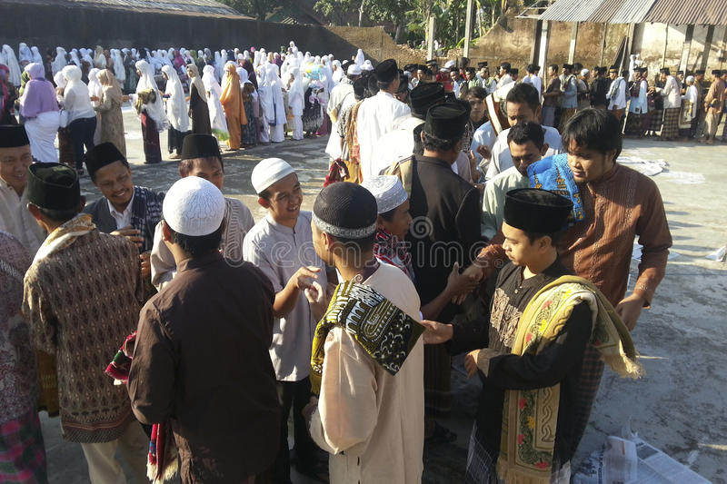 ISLAM IN INDONESIA. Muslims gather after the prayer of Eid El-Fitri in Banjarnegara, Java, Indonesia. Islam is the dominant religion in Indonesia, which also has royalty free stock photography