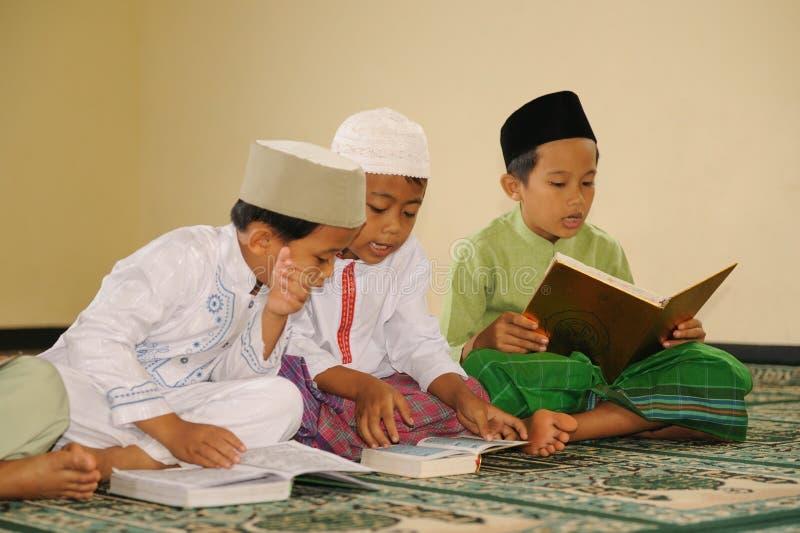 Islam Kids Reading Koran royalty free stock photos