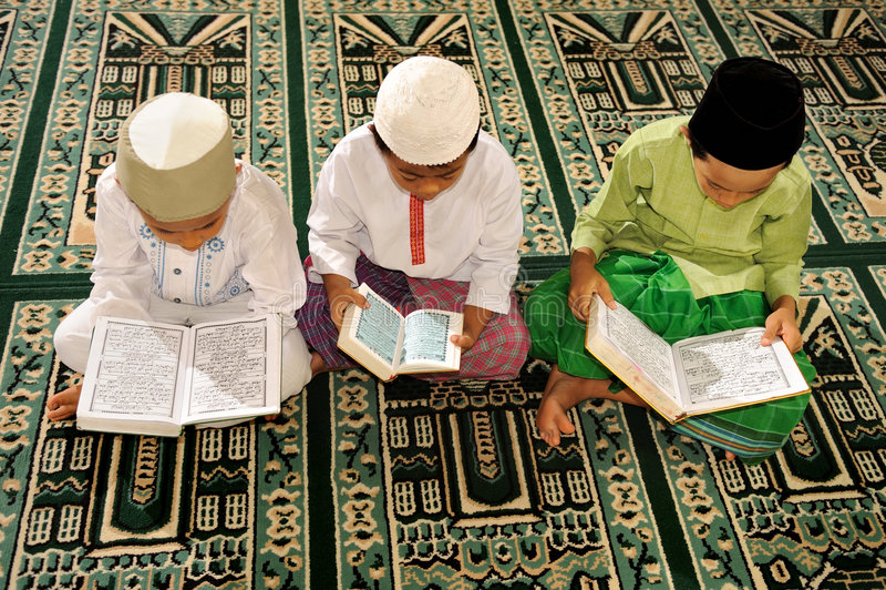 Islam Kids Reading Koran royalty free stock photo