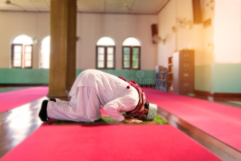 Islam muslim man in custom dress praying in mosque stock photography