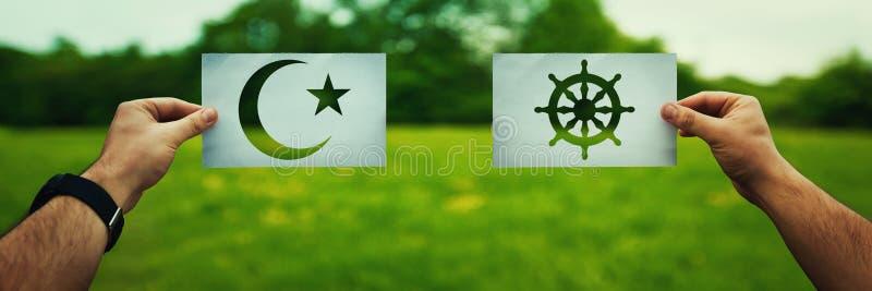 Islam versus Boeddhisme stock foto's