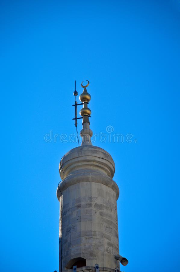Mosque minaret and blue sky. Islam, which has the characteristics of a piece of Ottoman architecture stock image