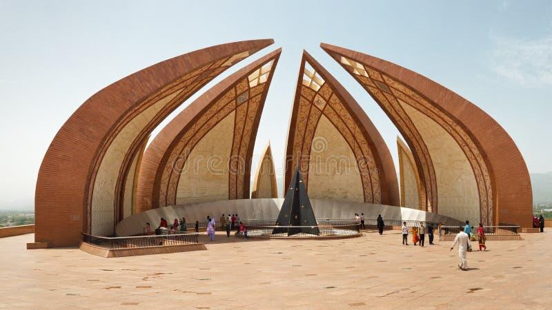 The Pakistan Monument in Islamabad. ISLAMABAD - JULY 16: Tourists at the Pakistan Monument on July 16, 2011 in Islamabad. The monument represents Pakistan's royalty free stock photo