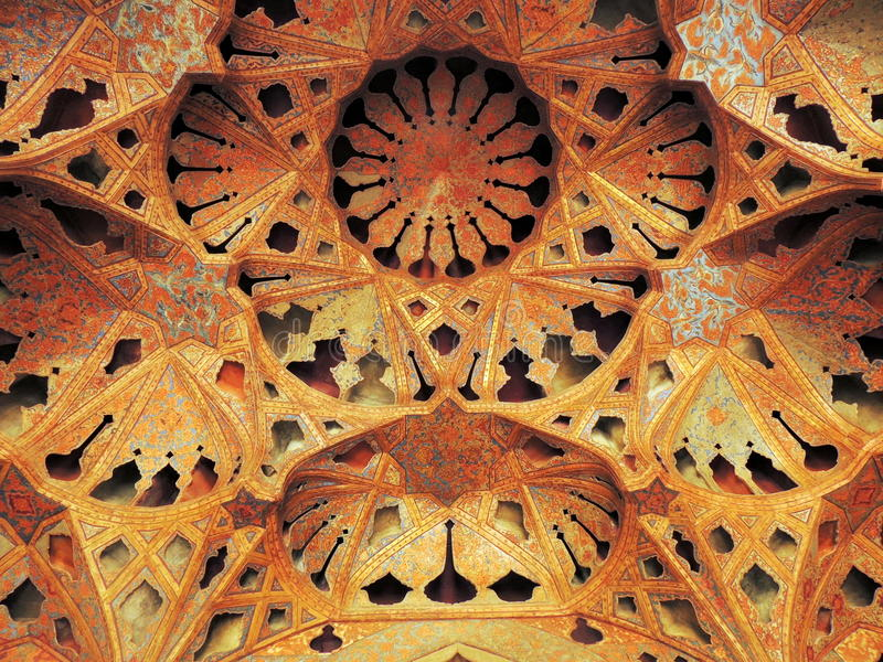 Islamic architecture dense beautiful detail of mosaics and volumes. Shapes of traditional music instruments and pottery adorn the ceiling of the Ali Qappu palace royalty free stock photography