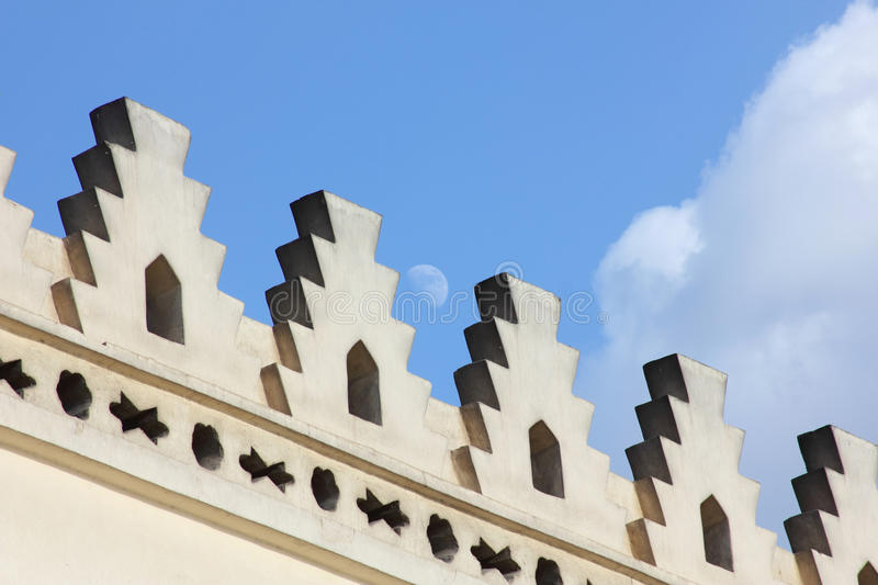 Islamic art with moon in egypt. Islamic art of an old vintage mosque located in cairo in egypt and the moon in blue sky background stock photography
