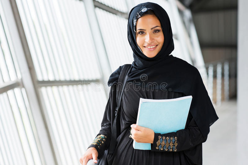 Islamic college girl. Attractive modern islamic college girl on campus royalty free stock photography