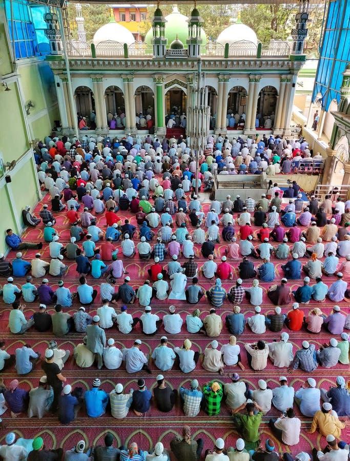 Islamic devotees offering prayers royalty free stock image