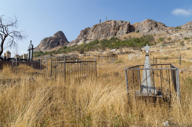 Islamic graveyard in Osh, Kyrgyzstan. Osh, Kyrgyzstan - October 05, 2014: A traditional muslim cemetery at the foot of Solomons Hill stock images