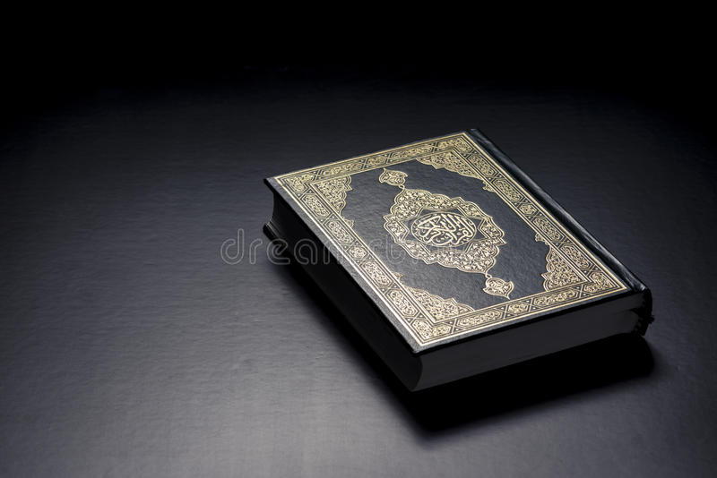 Islamic Holy Book. Quran Under Soft Light on Black Background royalty free stock photo