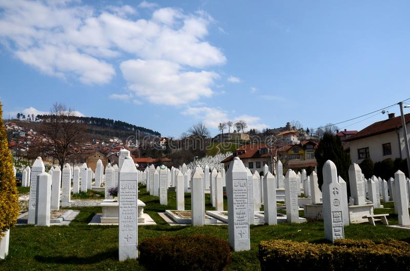 Islamic Muslim Tombstones of Bosnian soldiers at Martyrs Memorial Cemetery Sarajevo Bosnia. Sarajevo, Bosnia Hercegovina - March 23, 2015: Gravestones and tomb stock photo