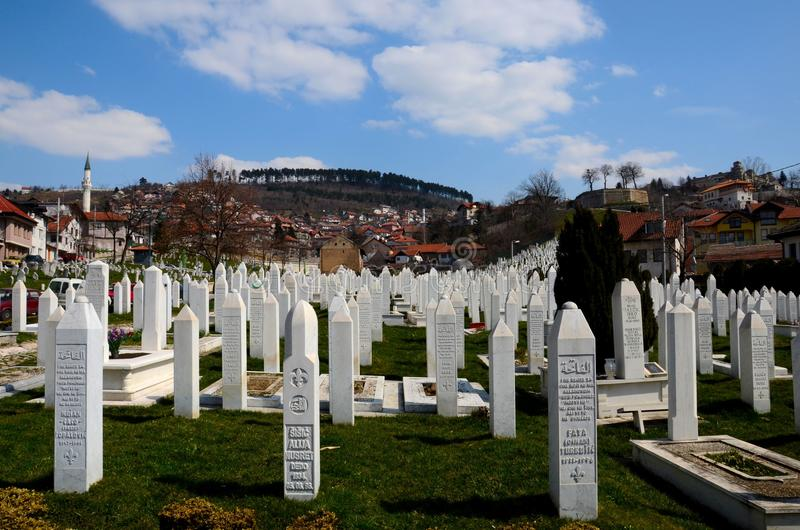 Islamic Muslim Tombstones of Bosnian soldiers at Martyrs Memorial Cemetery Sarajevo Bosnia. Sarajevo, Bosnia Hercegovina - March 23, 2015: Gravestones and tomb stock photography