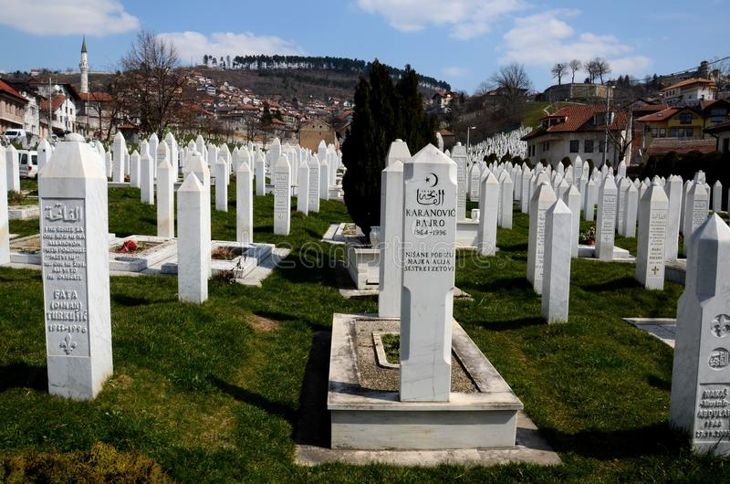 Islamic Muslim Tombstones of Bosnian soldiers at Martyrs Memorial Cemetery Sarajevo Bosnia. Sarajevo, Bosnia Hercegovina - March 23, 2015: Gravestones and tomb royalty free stock images