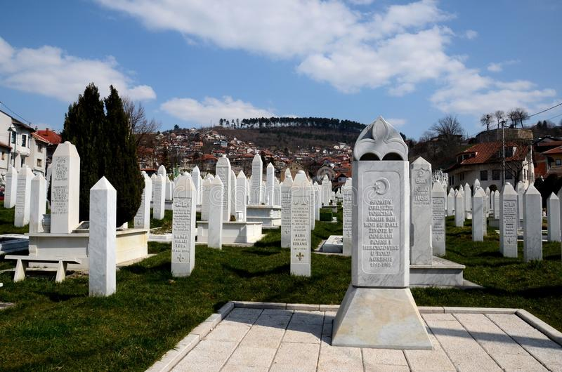 Islamic Muslim Tombstones of Bosnian soldiers at Martyrs Memorial Cemetery Sarajevo Bosnia. Sarajevo, Bosnia Hercegovina - March 23, 2015: Gravestones and tomb stock photos