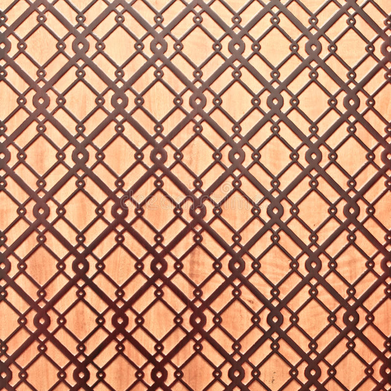 Islamic pattern. Geometric islamic pattern on a wooden surface as a background stock images