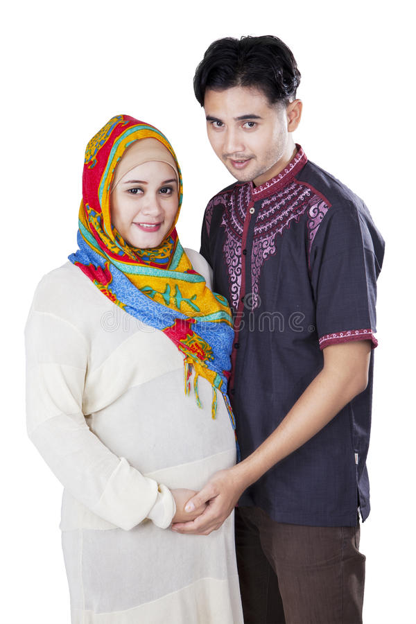Islamic pregnant female and her husband royalty free stock photos
