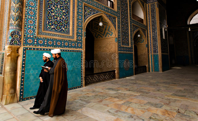 Islamic priests in Iran. Two Islamic priests walking in a mosque in Yazd, Iran. Islam is the predominant religion in Iran, most of them of the Shiite sect stock photos
