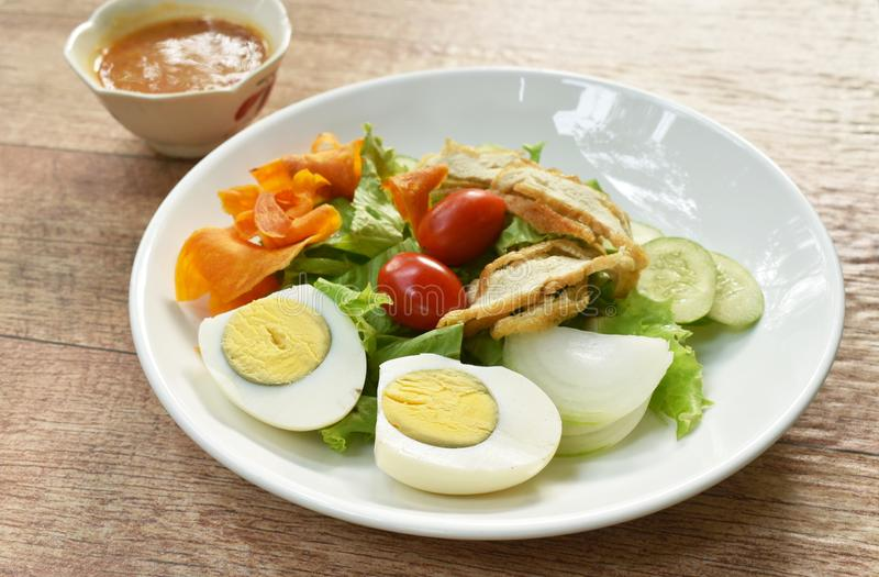 Islamic salad vegetable and boiled egg topping crispy fried taro dressing sweet bean sauce halal food on plate. Islamic salad vegetable and boiled egg topping royalty free stock photos