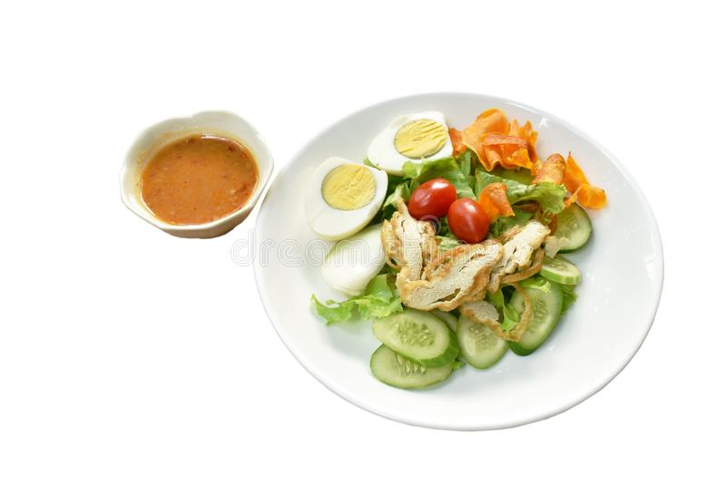 Islamic salad vegetable and boiled egg topping crispy fried taro dressing sweet bean sauce halal food on plate. Islamic salad vegetable and boiled egg topping stock images