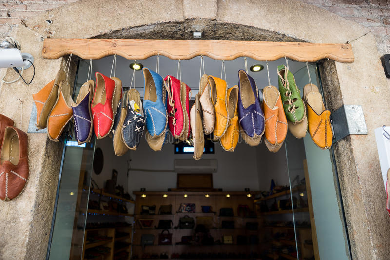 Islamic shoe shop. Leather shoes hanging on the store door, Istanbul Turkey royalty free stock photos