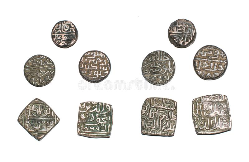Islamic Sultanate Coins of India. Old Antique Islamic Sultanate Coins of India made of billon metal alloy of Silver and Copper . Coin of Top is of Gujarat stock photo