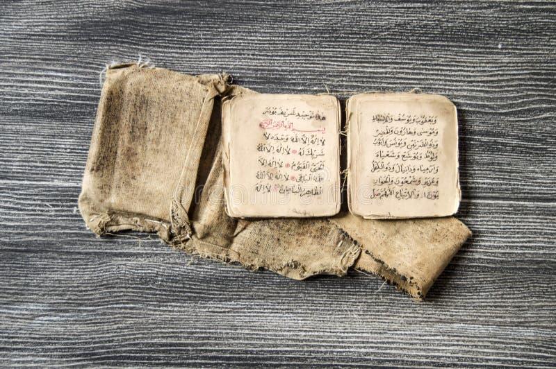Islamic texts and prayer books, very old religious books, Islamic books, Islamic books, Islamic symbols and prayer books,. Islamic prayer hat and robe, prayer royalty free stock photos