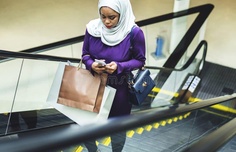 Islamic woman shopping at the mall royalty free stock photo