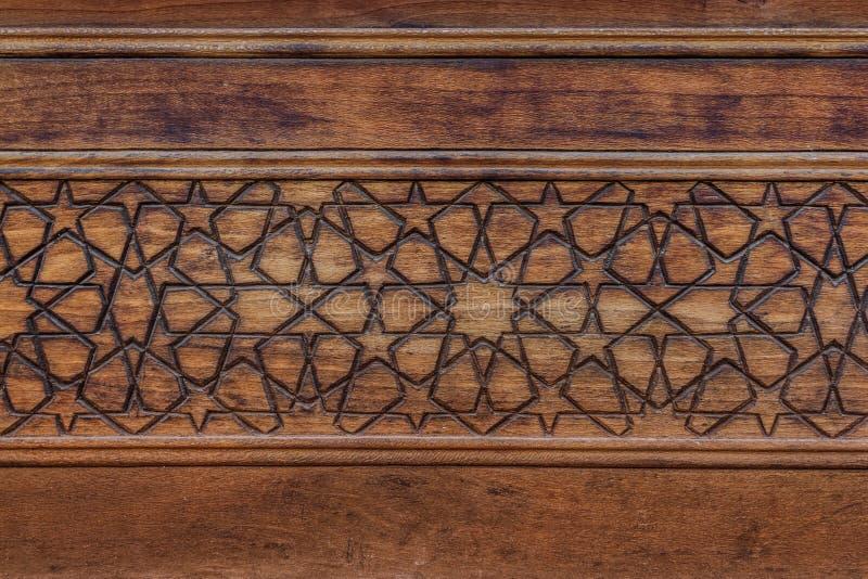 Islamitisch patroon Oude Islamitische decoratie met geometrische arabesque op hout royalty-vrije stock foto's