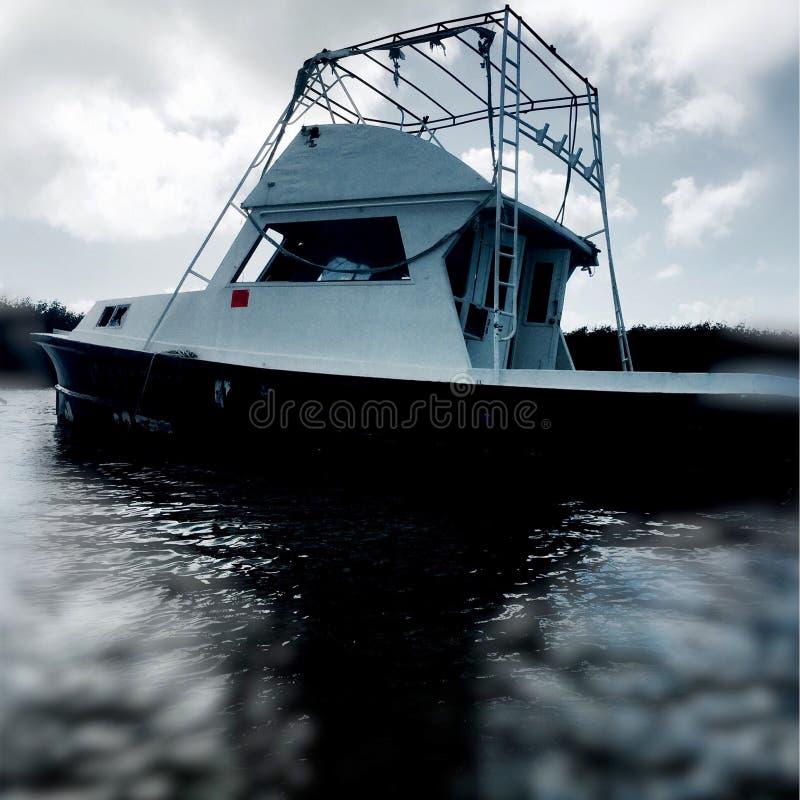 Islamorada Key, Florida. Kayaking through the Key of Islamorada Florida. Abandoned Fishing boat from one of the many Florida storms royalty free stock image