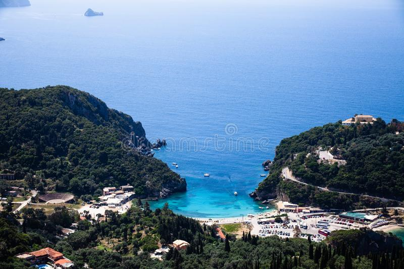 Island aerial view blue ocean behind. Beautiful Greek landscape. Corfu Greece natural places. Mountain next to sea water. Gorgeous stock photos