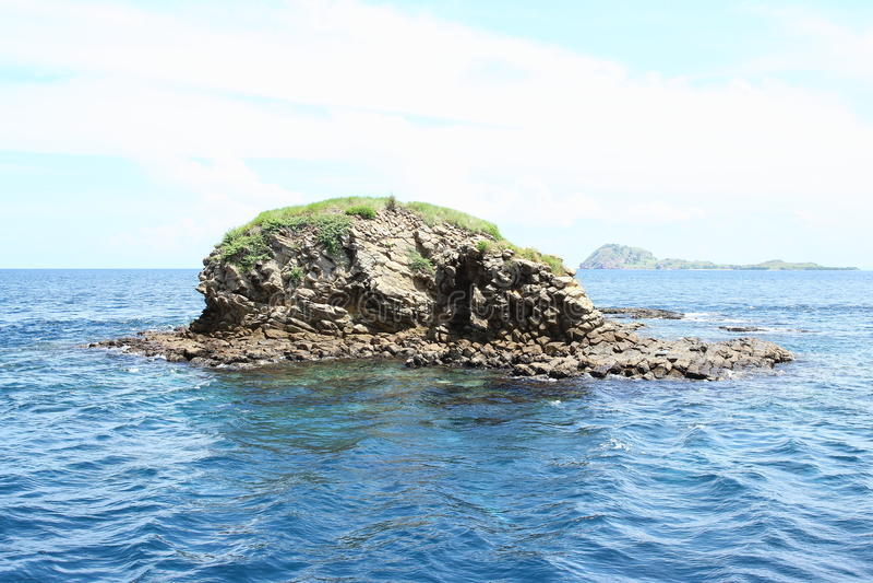 Island Batu Bolong. With hole in rocks in blue sea in Komodo National Park, Nusa Tengara Timur, Indonesia royalty free stock image