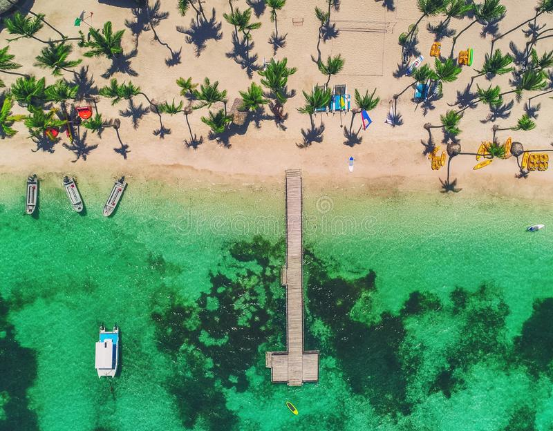 Island beach in Caribbean resort, Bavaro, Dominican Republic. Summer vacation. Aerial drone view over the seascape royalty free stock photos