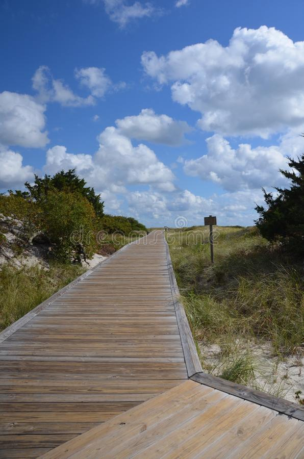 Island Beach State Park. In New Jersey is a narrow barrier between the mainland and the Atlantic Ocean. This boardwalk crosses the narrow stretch from bay to stock photos