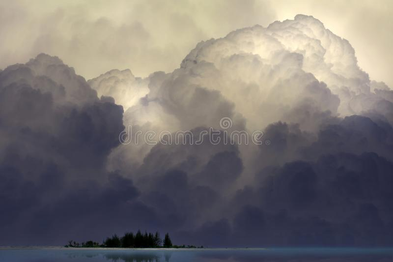 Island with the big clouds. Island and the big clouds stock images