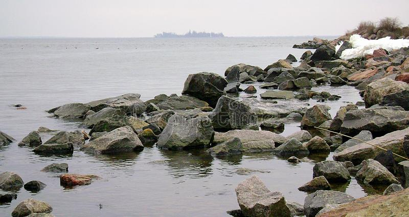 Ochacov. Winter Black Sea. Island in the Black Sea. Rocky beach. Boulders of granite on the shore of the Black Sea. Island in the Black Sea. Rocky beach royalty free stock photos