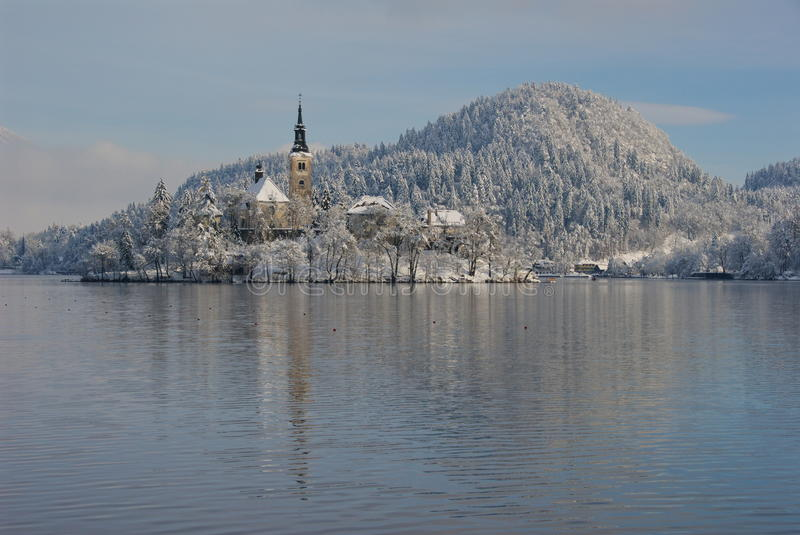 Island of Bled. And Mt. Straza in the winter,seen from the shore of lake Bled stock image
