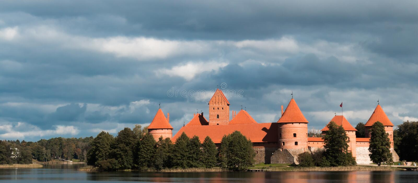 Island castle in Trakai, Lithuania. With a cloudy sky in the background royalty free stock photos