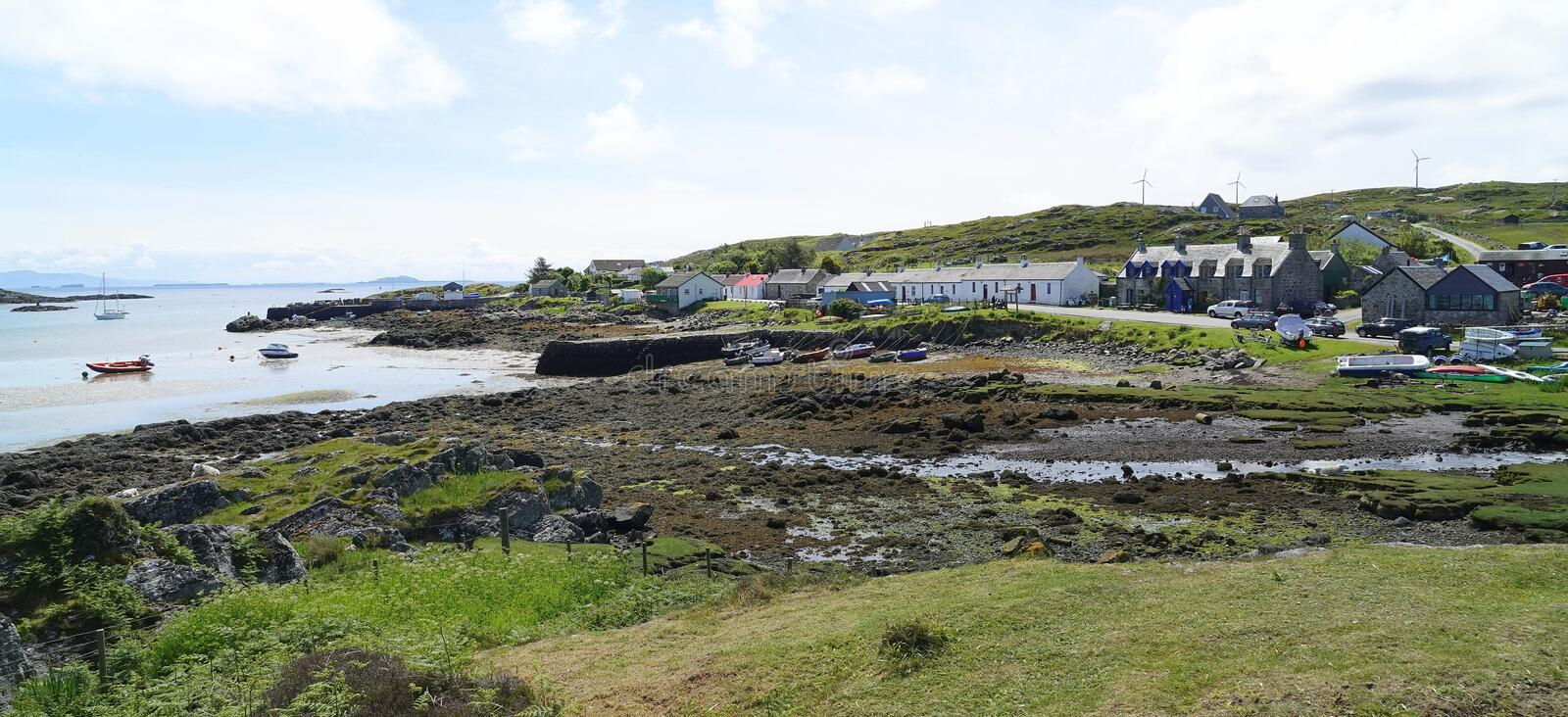 Island coastal village and harbour. The coastal village of Arinagour on the island of Coll in the Inner Hebrides in Scotland royalty free stock photo