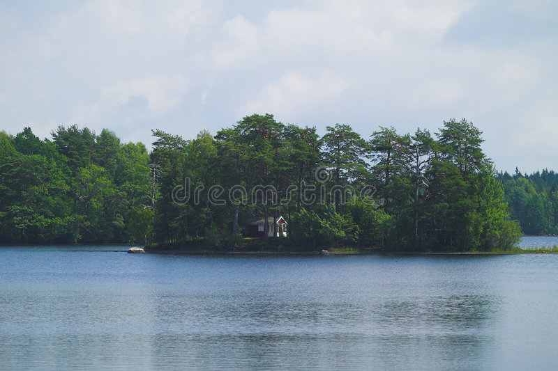 Island with cottage stock photo