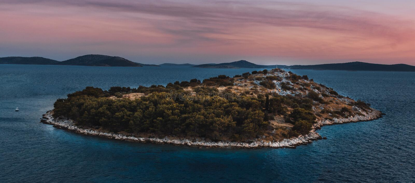 Island Covered in Trees Surrounded by Body of Water royalty free stock photos
