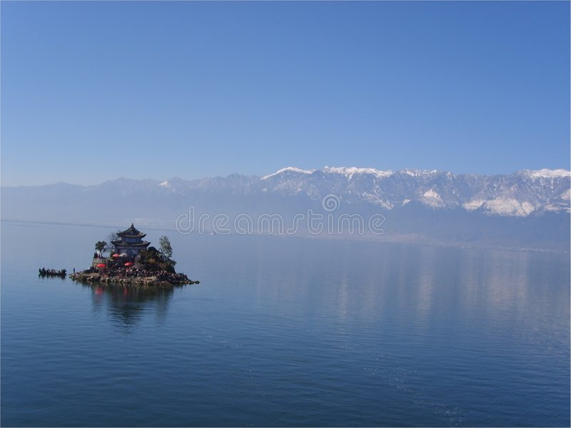 The island of dali. It's a small island in a beautiful lake which is beside a old town called dali of china.this island actually is a temple.the lake is called royalty free stock photo