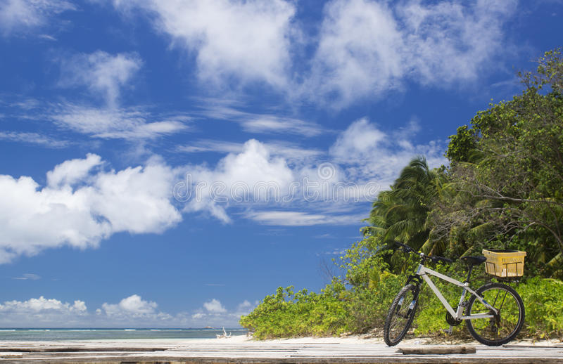 The island of dreams. Bicycle on moorage. La Digue island, Seyshelles. The island of dreams for a rest and relaxation.Bicycle on moorage royalty free stock photos