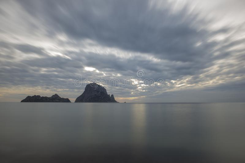 The island of es vedra of Ibiza in long exposure. Spain royalty free stock photography