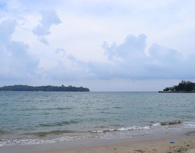 Island with Forest, Cloudy Sky, Calm Sea Waves at Sandy Beach - Landscape of Ross Island and Port Blair, Andaman Nicobar, India stock photography