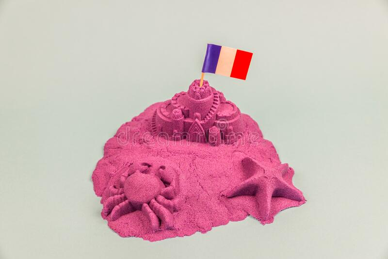 An island with France flag on a sand castle royalty free stock photo