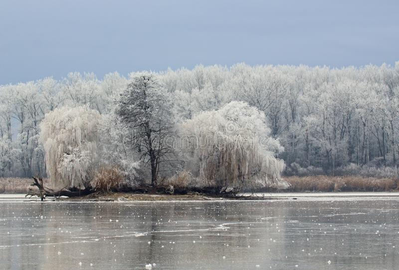 Download The Island On A Frozen Lake Stock Photo - Image: 83708945