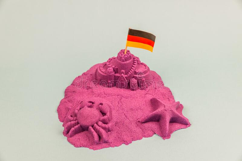 An island with Germany flag on a sand castle stock photography