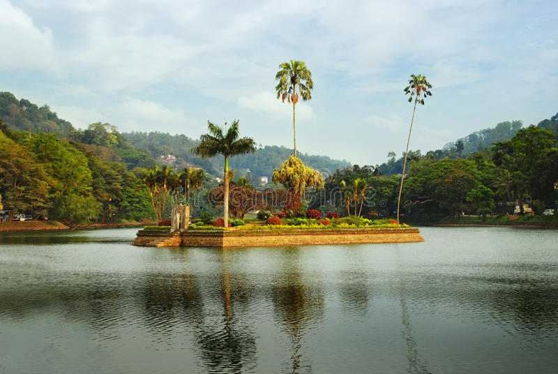 Island in Kandy lake, Sri Lanka. Island housing the Royal Summer House is in the middle of the Kandy lake, Sri Lanka stock images